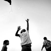 Tiavanni Jones, 6, of Rocky Mount, leaps into the air to catch bubbles.