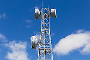 microwave parabolic dish antenna radio link on lattice tower against clouds in Gumlu, Queensland, Australia <br /> <br /> Editions:- Open Edition Print / Stock Image