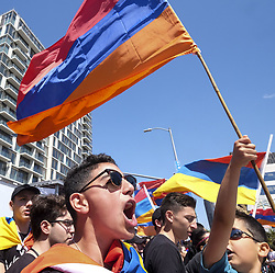 April 24, 2018 - Los Angeles, California, U.S - Thousands of Armenians carrying signs and Armenian flags march in Los Angeles, to mark the 103rd anniversary of the Armenian Genocide. (Credit Image: © Ringo Chiu via ZUMA Wire)