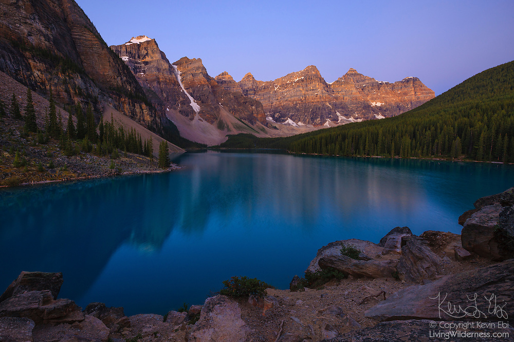 Several mountains in the Canadian Rockies reflect in the turquoise-colored Moraine Lake, located in Banff National Park, Alberta, Canada, at sunrise. This area is known as the Valley of the Ten Peaks, named for the ten tall mountains at the lake's edge. Moraine Lake has a unique aqua color that results from the silt deposited by glaciers.