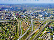 Nederland, Noord-Holland, Amsterdam; 16-04-2021; Knooppunt Amstel, Ring A10 en A2 (naar rechts richting Utrecht).  <br /> Linksonder volktuinencomplex Amstelglorie, grenzend aan Bedrijvenpark Zuidpark. Rechts van de Ring Amsterdam Amstel / Van der Madeweg.<br /> Amstel junction, Ring A10 and A2 (to the right towards Utrecht).<br /> Bottom left allotment garden complex Amstelglorie, adjacent to Zuidpark Business Park. To the right of the Ring Amsterdam Amstel / Van der Madeweg.<br /> <br /> luchtfoto (toeslag op standard tarieven);<br /> aerial photo (additional fee required)<br /> copyright © 2021 foto/photo Siebe Swart