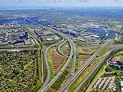 Nederland, Noord-Holland, Amsterdam; 16-04-2021; Knooppunt Amstel, Ring A10 en A2 (naar rechts richting Utrecht).  <br /> Linksonder volktuinencomplex Amstelglorie, grenzend aan Bedrijvenpark Zuidpark. Rechts van de Ring Amsterdam Amstel / Van der Madeweg.<br /> Amstel junction, Ring A10 and A2 (to the right towards Utrecht).<br /> Bottom left allotment garden complex Amstelglorie, adjacent to Zuidpark Business Park. To the right of the Ring Amsterdam Amstel / Van der Madeweg.<br /> <br /> luchtfoto (toeslag op standard tarieven);<br /> aerial photo (additional fee required)<br /> copyright © 2021 foto/photo Siebe Swart