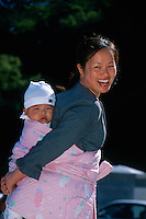 Mother carrying baby on back in traditional Korean manner, Tongdosa Temple, north of Pusan, South Korea