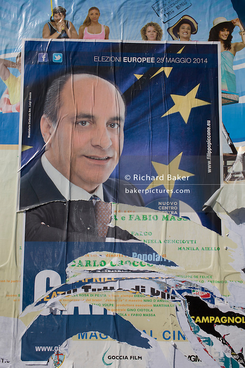 The face of Neapolitan politician Fillippo Piccone on a European elections poster in Naples, Italy.