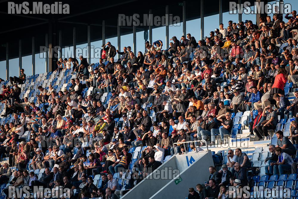 LAUSANNE, SWITZERLAND - SEPTEMBER 22: A view of people attending the game as the sun goes down during the Swiss Super League match between FC Lausanne-Sport and BSC Young Boys at Stade de la Tuiliere on September 22, 2021 in Lausanne, Switzerland. (Photo by Basile Barbey/RvS.Media/)