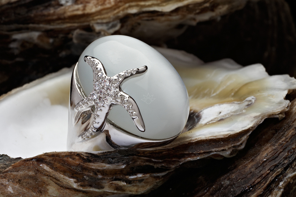 This image of a pearl ring, was produced as a test for Starboard, a local jewelry company. This silver piece is shot on a bed of oysters.