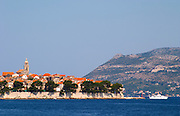 View across the sea on the town of Korcula on the island of the same name where Marco Polo was born Korcula Island. Korcula Island. Dalmatian Coast, Croatia, Europe.