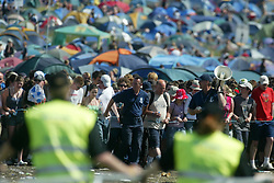 Fans arrive at the main area on the morning of Sunday 10th July, 2005 at the two-day T in the Park festival, at Balado, Kinross-shire, Scotland..