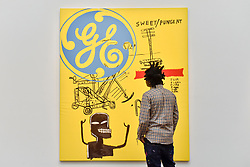 """© Licensed to London News Pictures. 23/06/2017. London, UK. Artist Bradley Theodore views """"Sweet Pungent"""", 1984-85, a collaborative work by Andy Warhol and Jean-Michael Basquiat (estimate GBP1.4-1.8m) at the preview of Sotheby's Contemporary Art Sale in New Bond Street.  The auction, which is dominated by Pop art, takes place on 28 June. Photo credit : Stephen Chung/LNP"""