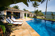Private home in Parati Brazil. Veiw of the guest house, the main house, pool, graden and private beach.