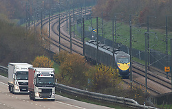 © Licensed to London News Pictures. 25/11/2020. <br /> Maidstone, UK. Freight lorries travelling to Europe could see more checks at the borders. Lorries today on the M20 heading for Dover in Kent with the Eurostar train travelling alongside the motorway to Europe. When the Brexit transition period ends on December 31st 2020 new rules will apply to people travelling to and from Europe with some rules subject to ongoing UK an EU negotiations. Photo credit:Grant Falvey/LNP