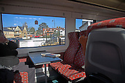 Inside train  carriage travelling past town of Woodbridge, Suffolk