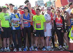 © Licensed to London News Pictures. 21/04/2013. London, England. Celebrity Runners at a photocall before the start of the Virgin London Marathon 2013 race. Many wore black ribbons to pay their respect for those who died or were injured in the Boston Marathon. Photo credit: Bettina Strenske/LNP