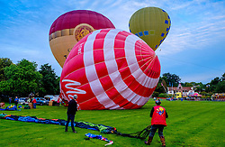 Strathaven Scotland UK 27th August 2016 - The Strathaven Balloon Festival is an annual event and the only one of its kind in Scotland held in 2016 from 26th - 28th August. The first flights of the festival took place at dawn on Saturday 27th August <br /> <br /> First balloons take to the sky on a beautiful calm morning.<br /> <br /> (c) Andrew Wilson | Edinburgh Elite media
