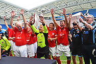 The England over 60's celebrate with the Just International Cup after the trophy presentation whichbthey won 3-0 during the world's first Walking Football International match between England and Italy at the American Express Community Stadium, Brighton and Hove, England on 13 May 2018. Picture by Graham Hunt.