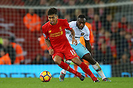 Roberto Firmino of Liverpool under pressure from Michail Antonio of West Ham United. Premier League match, Liverpool v West Ham Utd at the Anfield stadium in Liverpool, Merseyside on Sunday 11th December 2016.<br /> pic by Chris Stading, Andrew Orchard sports photography.