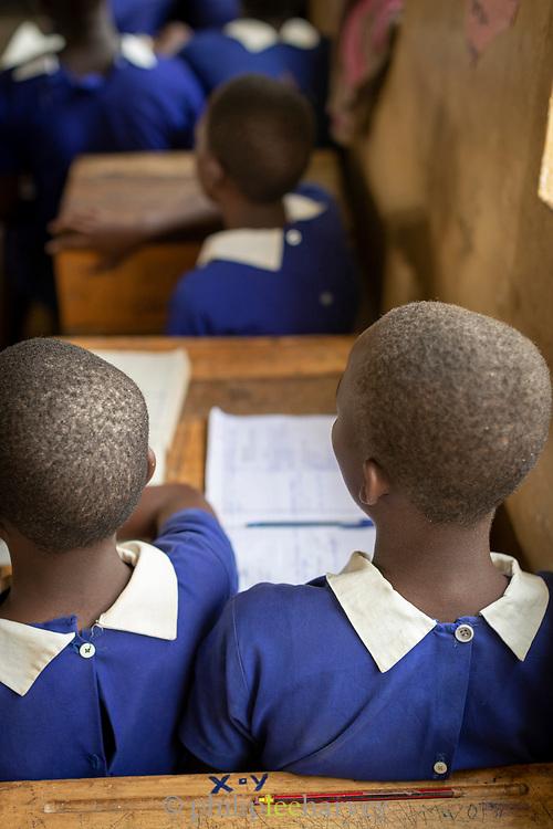 Rear view of girls sitting in Musoto Christian School, Uganda