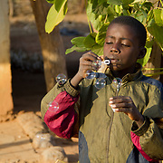 Blowing bubbles, a gift from Peace Corps volunteer Rachael, who salvaged it from a friend's wedding in the US! Koumbadiouma, Kolda, Senegal.
