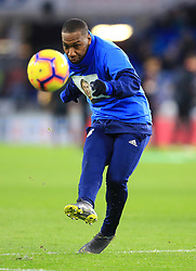 Cardiff City's Junior Hoilett warms up ahead of the match whilst wearing a Emiliano Sala commemorative t-shirt during the Premier League match at the Cardiff City Stadium.