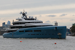 © Licensed to London News Pictures. 12/09/2018. London, UK.  Billionaire Spurs owner, Joe Lewis's 321 feet long luxury superyacht Aviva leaves London passing Tower Bridge on the River Thames following a London visit. Aviva, worth an estimated £113m is one of a growing number of superyachts to visit the capital this year and moored near Butlers Wharf for a number of weeks, during which wealthy homeowners criticised the Spurs owner for spoiling their river view.  Photo credit: Vickie Flores/LNP