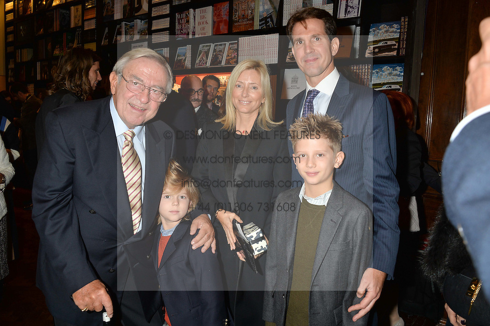 KING CONSTANTINE OF GREECE with his son CROWN PRINCE PAVLOS OF GREECE, CROWN PRINCESS MARIE CHANTAL OF GREECE and PRINCE ARISTIDIS-STAVROS OF GREECE (red jumper) and PRINCE ODYSSEUS-KIMON OF GREECE at a party to celebrate the launch of the Maison Assouline Flagship Store at 196a Piccadilly, London on 28th October 2014.  During the evening Valentino signed copies of his new book - At The Emperor's Table.