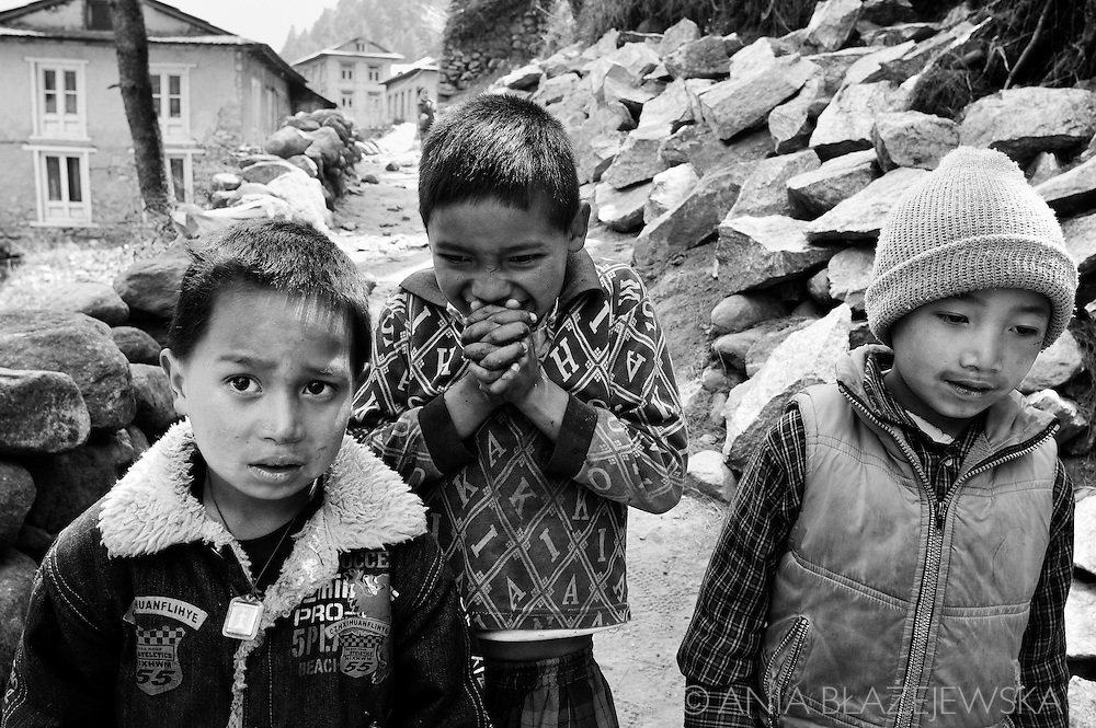 Nepal, Himalayas. Three Sherpa boys from the mountain village in the Everest region.