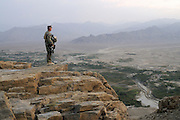 """US Marine Colonel Jeff Haynes, Commanding Officer, 201st Regional Corps Advisory Command, on a ridge overlooking the Tagab Valley. ..  ..One of the main tactics is a new road through Tagab Valley that will allow traffic to bypass Kabul providing a more direct link between Pakistan and destinations north including Uzbekistan and Tajikistan.....To win the Tagab Valley, Colonel Haynes said, """"The creeping barrage of goodness, really centers on the road going up the valley, because then you can begin development projects and increase prosperity.  The cab fare for villagers went from $8 down to $1 just because the ANA graded the road.""""  As the ANA move north through the valley they are building combat outposts to sustain the gains.  Haynes confirmed this is an ANA campaign - the first of its kind - his soldiers are mentoring the ANA, there are no coalition troops.  .."""