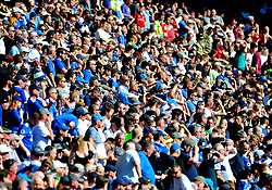 Cardiff City fans watch the match from the stands- Mandatory by-line: Nizaam Jones/JMP - 21/04/2019 -  FOOTBALL - Cardiff City Stadium - Cardiff, Wales -  Cardiff City v Liverpool - Premier League