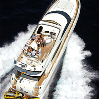 Aerial view of a 74 foot Yacht named Tuono under full throttle in the Atlantic Ocean off Miami Beach.