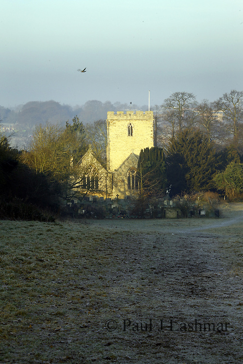 St Botophs Parish Church, Barton Seagrave Northamptonshire, seen from 'The Spinney' on a frosty winter morning.