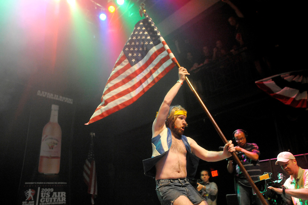 Photo copyright 2009, Matt Roth.Friday, August 7, 2009.The 9:30 Club Washington D.C...2009 National Air Guitar Champ William Ocean performs during the second round of competiton during the 2009 U.S. Air Guitar Championships at the 9:30 Club in Washington D.C. Friday, August 7, 2009.