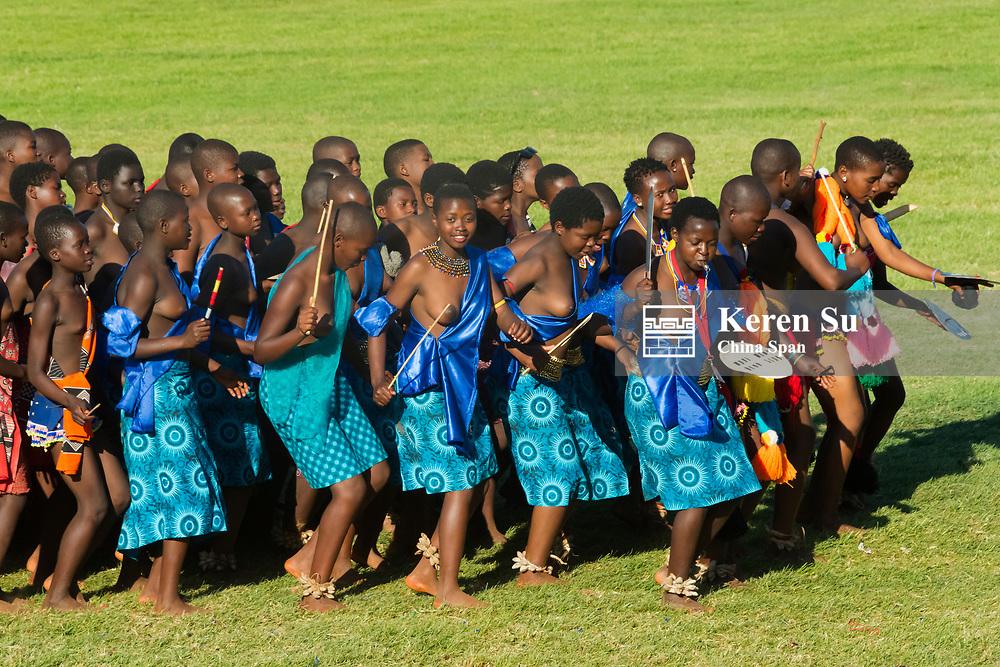 Swazi girls carrying sword parade at Umhlanga (Reed Dance Festival), Swaziland