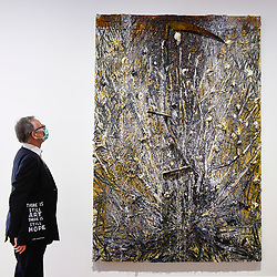 "© Licensed to London News Pictures. 16/06/2020. LONDON, UK. A visitor, wearing a facemask and carrying a bag with a topical message, views ""Memento Mori"", 2020, by Anselm Kiefer on the opening day of a new exhibition ""Art Basel at Ely House"" taking place at Galerie Thaddaeus Ropac in Mayfair.  The commercial gallery has implemented social distancing guidelines for visitors for its reopening after coronavirus pandemic lockdown restrictions were relaxed by the UK government.  The exhibition runs 16 June to 31 July 2020.  Photo credit: Stephen Chung/LNP"