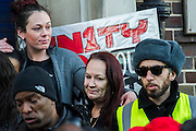 "Supporters of Mark Duggan's family hold a vigil outside Tottenham  police station. They gathered, alongside family members and his mother Pam Duggan (pictured) , at 2pm following an inquest jury ruling that Duggan was lawfully killed when police shot him dead while he was unarmed.  Within days of his shooting, in 2011, rioting broke out on the streets of London, and spread to other urban areas in England.  Pastor Nims Obunge, who oversaw Duggan's funeral in 2011, said: ""The message from the family is that this vigil is intended to be a very peaceful vigil"". Tottenham, London, UK 11 January 2014. Guy Bell, 07771 786236, guy@gbphotos.com"