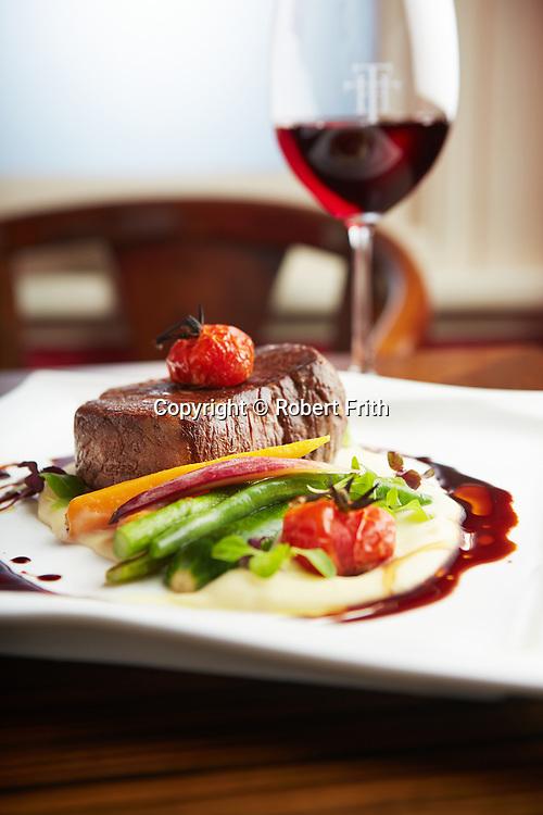 Eye fillet 300g, truffled potato, vine roasted cherry tomato, sauteed greens, red wine jus