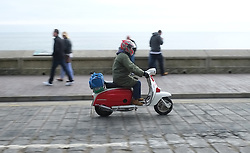 © Licensed to London News Pictures. <br /> 05/04/2015. <br /> <br /> Scarborough, United Kingdom<br /> <br /> A scooter is ridden along the sea front on Easter Sunday during the Scarborough Scooter Rally.<br /> <br /> Photo credit : Ian Forsyth/LNP