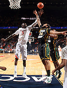 CHARLOTTESVILLE, VA- DECEMBER 6: Assane Sene #5 of the Virginia Cavaliers reaches for the loose ball with Ryan Pearson #24 of the George Mason Patriots during the game on December 6, 2011 at the John Paul Jones Arena in Charlottesville, Virginia. Virginia defeated George Mason 68-48. (Photo by Andrew Shurtleff/Getty Images) *** Local Caption *** Assane Sene;Ryan Pearson