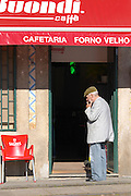 cafe and old man porto portugal