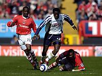 Photo: Olly Greenwood.<br />Charlton Athletic v Portsmouth. The Barclays Premiership. 17/04/2006. Portsmouths Benjani Mwaruwari goes past Charltons Chris Powell and Jerome Thomes