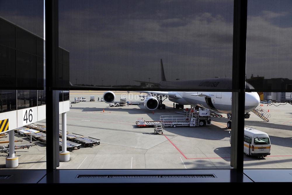 passenger airplane being prepared for the next flight at Narita airport Japan Tokyo