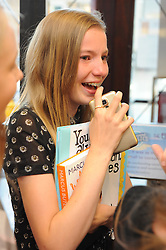 © Licensed to London News Pictures. 08/08/2015 <br /> Crying with happiness teenage girl.  <br /> Blogger MARCUS BUTLER at Waterstones bookshop in Bluewater,Kent today meeting fans and signing copies of his book.<br /> (Byline:Grant Falvey/LNP)