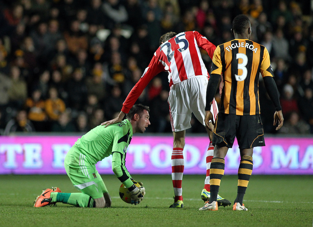 Stoke City's Peter Crouch checks on Man of the Match Hull City's Allan McGregor after McGregor was winded in an aerial battle between the two players<br /> <br /> Photo by Rich Linley/CameraSport<br /> <br /> Football - Barclays Premiership - Hull City v Stoke City - Saturday 14th December 2013 - Kingston Communications Stadium - Hull <br /> <br /> © CameraSport - 43 Linden Ave. Countesthorpe. Leicester. England. LE8 5PG - Tel: +44 (0) 116 277 4147 - admin@camerasport.com - www.camerasport.com
