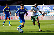 AFC Wimbledon midfielder Callum Reilly (33) battles for possession with Plymouth Argyle attacker Frank Nouble (7) during the EFL Sky Bet League 1 match between AFC Wimbledon and Plymouth Argyle at the Kiyan Prince Foundation Stadium, London, England on 19 September 2020.