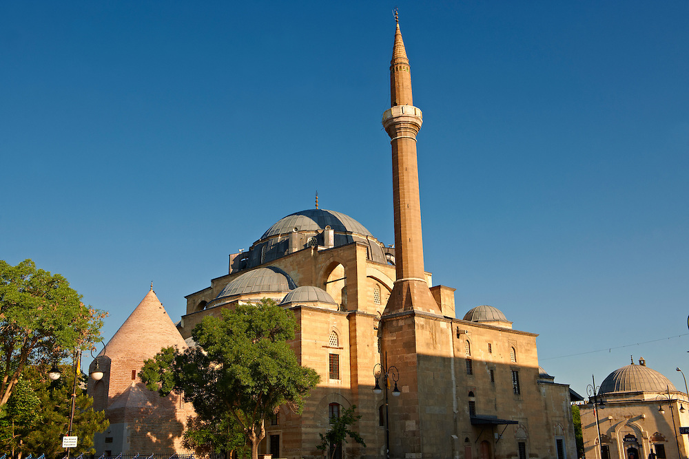 The Mevlana museum, with the blue domed   mausoleum of Jalal ad-Din Muhammad Rumi, a Sufi mystic also known as Mevlâna or Rumi. It was also the dervish lodge (tekke) of the Mevlevi order, better known as the whirling dervishes. Mevlâna died on 17 December 1273. Konya, Turkey .<br /> <br /> If you prefer to buy from our ALAMY PHOTO LIBRARY  Collection visit : https://www.alamy.com/portfolio/paul-williams-funkystock/konya.html<br /> <br /> Visit our TURKEY PHOTO COLLECTIONS for more photos to download or buy as wall art prints https://funkystock.photoshelter.com/gallery-collection/3f-Pictures-of-Turkey-Turkey-Photos-Images-Fotos/C0000U.hJWkZxAbg