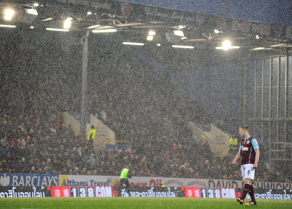 Burnley's Ben Mee stands in the snow in the second half<br /> <br /> Photographer Chris Vaughan/CameraSport<br /> <br /> Football - Barclays Premiership - Burnley v Crystal Palace - Saturday 17th January 2015 - Turf Moor - Burnley<br /> <br /> © CameraSport - 43 Linden Ave. Countesthorpe. Leicester. England. LE8 5PG - Tel: +44 (0) 116 277 4147 - admin@camerasport.com - www.camerasport.com