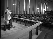 """Fr Niall O'Brien says Thanksgiving Mass.1984..16.07.1984..07.16.1984..16th July 1984..In celebration of his safe homecoming from the Philippines,Fr Niall O'Brien said a thanksgiving mass At Newtownpark Ave,Blackrock,Dublin. Along with two other priests and six lay people,Fr Niall was falsly accused of multiple murders.They became known as """"The Negros Nine"""".After President Reagan visited Ireland,The American government put pressure on the Marcos regime and all charges were dropped and all were fully exonerated...Image of Fr Niall O'Brien as he address a packed congregation from the altar...Note; Fr O'Brien, who was born in Dublin in 1939,died in Pisa, Italy in 2004"""