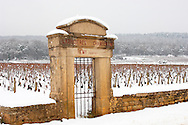 vineyard gate in the snow. Chambertin Clos de Vin - Cote D'or, beaune, France. .<br /> <br /> Visit our FRANCE HISTORIC PLACES PHOTO COLLECTIONS for more photos to download or buy as wall art prints https://funkystock.photoshelter.com/gallery-collection/Pictures-Images-of-France-Photos-of-French-Historic-Landmark-Sites/C0000pDRcOaIqj8E
