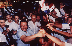 Panamanian dictator Manuel Noriega reaches out to flag-waving supporters as body guards watch at a rally outside of Panama City in 1988. One-time Panamanian dictator Manuel Noriega is being remembered as a ruthless strongman of volatile CIA operative and a brash drug trafficker. Noriega was removed from office in the 1989 U.S. invasion of Panama. He died last night at 83. Photo by David Walters/The Miami Herald/TNS/ABACAPRESS.COM