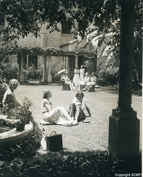1931 Ladies relax in the backyard of the Hollywood Studio Club on Lodi Pl.