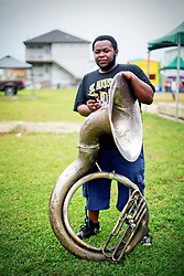 29 August 2014. Lower 9th Ward, New Orleans, Louisiana. <br /> Survivors of the storm. Michael Brooks and his sousaphone on Tennessee Street in the Lower 9th Ward.<br /> Photo; Charlie Varley/varleypix.com